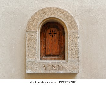 Medieval wine portal (Buchette del vino) – unique Florentine architecture detail - Shutterstock ID 1323200384