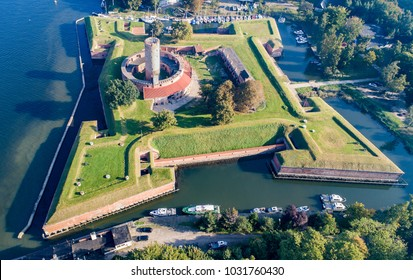 Medieval Wisloujscie Fortress with old lighthouse tower in port of Gdansk, PolandA unique monument of the fortification works. Aerial view
