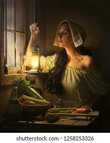 Medieval Woman with Vintage Lantern inside House.