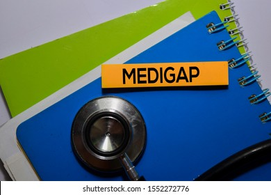 Medigap write on sticky note. Medical or healthcare concept