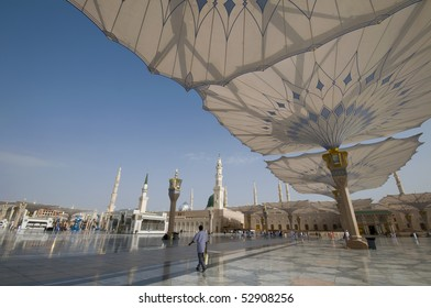 MEDINA - APRIL 22 : Pilgrims walk underneath giant umbrellas at Nabawi Mosque compound on April 22, 2010 in Medina, Kingdom of Saudi Arabia. Nabawi mosque is the second holiest mosque in Islam.