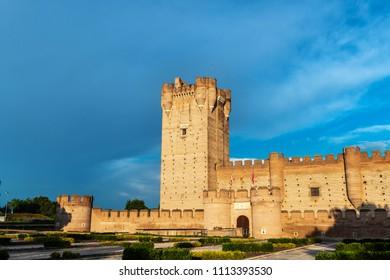 MEDINA DEL CAMPO, SPAIN - JUNE 2, 2018: Panorama view of the famous castle Castillo de la Mota in Medina del Campo at dusk, Valladolid.