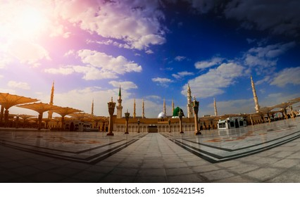 MEDINA, KINGDOM OF SAUDI ARABIA (KSA) - March 24: Muslims in front of the mosque of the Prophet Muhammad on March 24, 2018 in Medina, KSA. Prophet's tomb is under the green dome.