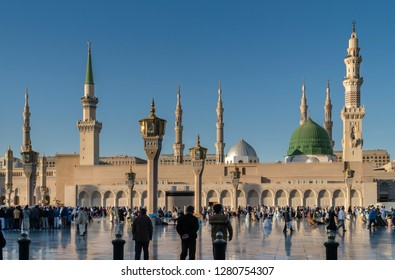 MEDINA, KINGDOM OF SAUDI ARABIA (KSA) - FEB 5: Muslims marching in front of the mosque of the Prophet Muhammad on February 2, 2017 in Medina, KSA. Prophet's tomb is under the green dome.