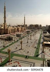 MEDINA, KINGDOM OF SAUDI ARABIA (KSA) - JANUARY 14 : Muslims walk on the boulevard of Nabawi Mosque January 14, 2008 in Medina, KSA. Nabawi Mosque is the second holiest mosque in Islam.