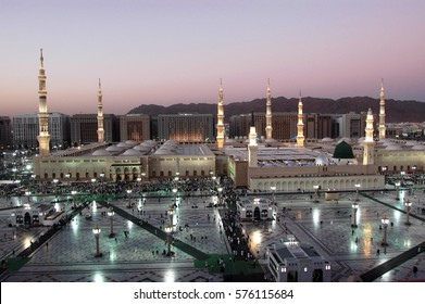 MEDINA, KINGDOM OF SAUDI ARABIA (KSA), Muslims in front of the mosque of the Prophet Muhammad, 2005 in Medina, KSA. Prophet's tomb is under the green dome.
