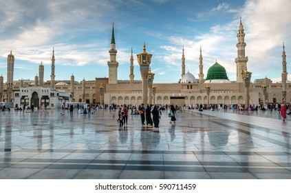 MEDINA, KINGDOM OF SAUDI ARABIA (KSA) - FEB 1: Muslims marching in front of the mosque of the Prophet Muhammad on February 1, 2017 in Medina, KSA. Prophet's tomb is under the green dome.