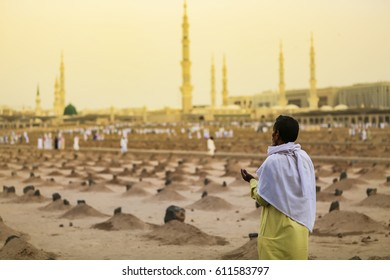 MEDINA, KINGDOM OF SAUDI ARABIA (KSA) - March 24: Muslims in front of the mosque of the Prophet Muhammad on March 24, 2016 in Medina, KSA. Prophet's tomb is under the green dome.