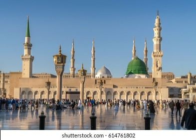 MEDINA, KINGDOM OF SAUDI ARABIA (KSA) - FEB 2: Muslims marching in front of the mosque of the Prophet Muhammad on February 2, 2017 in Medina, KSA. Prophet's tomb is under the green dome.
