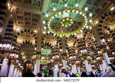 MEDINA - MARCH 06 : Pilgrims walk out after praying at Nabawi Mosque compound on March 06, 2015 in Medina, Kingdom of Saudi Arabia. Nabawi mosque is the second holiest mosque in Islam.