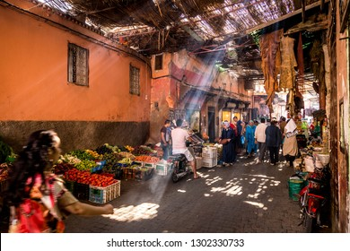 Medina, Marrakesh, Morocco - October 1, 2014: Local moroccan people at traditional market or bazaar in Medina, Marrakesh, Morocco, Africa