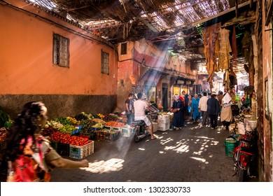 Medina, Marrakesh, Morocco - October 1, 2014: Local moroccan people at traditional market or bazaar in Medina, Marrakesh, Morocco, Africa