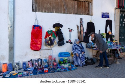 Medina of Rabat Souk, Rabat, Morocco, April 24 2019. A market seller serving a customer and selling goods on the street in Rabat at the entrance to the souk.