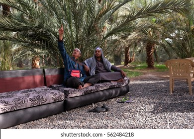 MEDINA, SAUDI ARABIA - 1 DECEMBER 2016 : Muslim pilgrims relax in a dates farm during pilgrimage trip in Medinah.