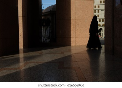 MEDINA, SAUDI ARABIA - 1 DECEMBER 2016 : Women wearing abaya leaving for a prayer at Nabawi Mosque. Medina is one of the two harams ( a land prohibited to non Muslims).
