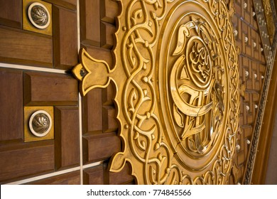 MEDINA, SAUDI ARABIA - 16TH NOV 2017; Close-up view of golden door for Mosque Al-Nabawi in Medina, Saudi Arabia. It is the second-holiest site in Islam and the mosque was built by Prophet Muhammad