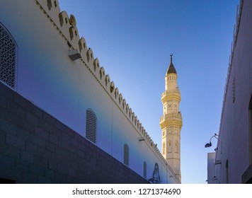 Medina, Saudi Arabia, 2018 Dec 8: Image of one of minarets at Quba Mosque with beautiful cloudless blue sky background. Selective focus at center. Others in gradient blur.