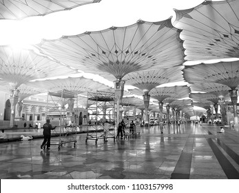 MEDINA, SAUDI ARABIA -8th SEPTEMBER 2017, Mosque of the Prophet Muhammad during beautiful sunrays at morning. Staff of Medina Mosque walking and cleaning around the mosque. Image on black and white.