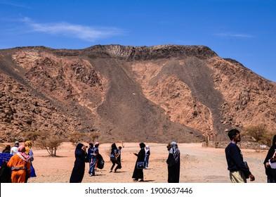MEDINA, SAUDI ARABIA - April 2 2015: Muslim pilgrims on Uhud Mountains after Umrah during summer holidays