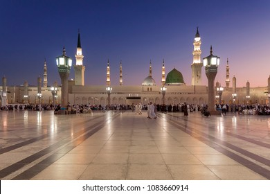 Medina, Saudi Arabia - April 21 2013: People Gather around Green Dome at Nabawi Mosque.