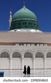 Medina, Saudi Arabia - April 21 2013: Girls Praying at Green Dome at Masjid Nabawi