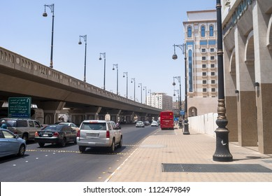 MEDINA, SAUDI ARABIA - APRIL 28 2018: Streets and roads of Medina, outside the center. Poor infrastructure and roads, old cars, poor buildings. Real life in Saudi Arabia