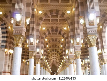 MEDINA, SAUDI ARABIA - APRIL 28 2018: Interior inside beautiful Masjid Al Nabawi or Prophet Muhammed Mosque in the center of Holy Medina. People and pilgrims are praying to Allah