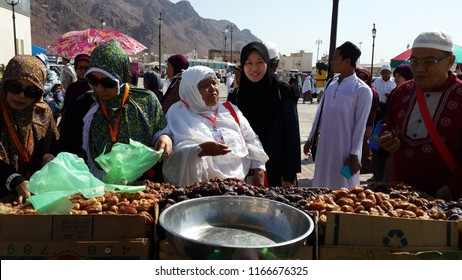 MEDINA, SAUDI ARABIA- AUGUST 28, 2018:  Muslims buying  various types of dates and other dried food.