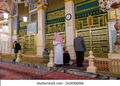 MEDINA, SAUDI ARABIA - CIRCA 2014 :  Pilgrims make a prayer behind the burial chamber of Prophet Muhammad (pbuh) and his 2 companions in Al Madinah, Saudi Arabia.