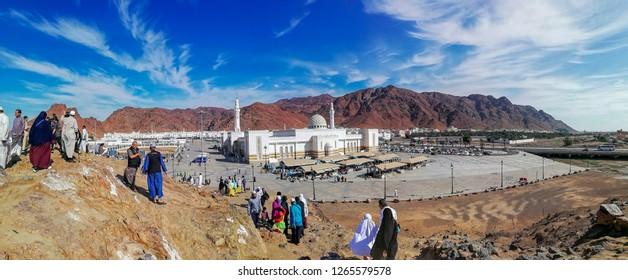 Medina, Saudi Arabia - December 13, - 2018 : Unidentified Muslim tourists and pilgrims visiting The Martyrs of Uhud at Mount Uhud during umrah and Hajj season. Crop fragment.