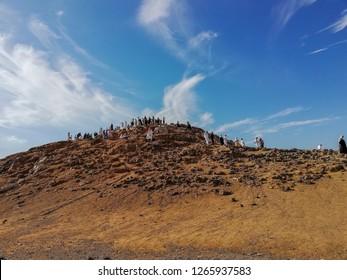Medina, Saudi Arabia - December 13, 2018; Unidentified Muslim tourists and pilgrims visiting The Martyrs of Uhud at Mount Uhud during umrah and Hajj season. Selective focus.