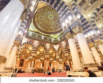 Medina, Saudi Arabia - DICEMBER 6  2018:Pilgrims at the Nabawi Mosque at Medina, Saudi Arabia. Nabawi mosque originally built by the Islamic prophet Muhammad, situated in the city of Medina in Saudi A