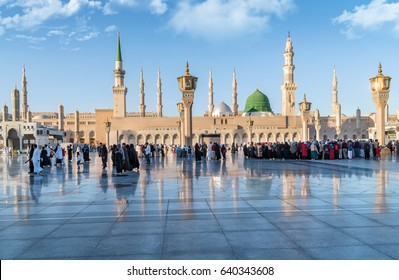 MEDINA, SAUDI ARABIA - FEB 2: Muslims marching in front of the mosque of the Prophet Muhammad on February 2, 2017 in Medina, KSA. Prophet's tomb is under the green dome.