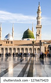MEDINA, SAUDI ARABIA - FEB 8: Muslims marching in front of the mosque of the Prophet Muhammad on February 8 , 2016 in Medina, KSA. Prophet's tomb is under the green dome