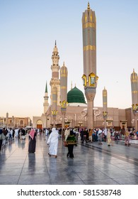 MEDINA, SAUDI ARABIA - FEBRUARY 17, 2017: Muslim pilgrimage at Al-Masjid An-Nabawi often called the Prophet Mosque is second holiest site in Islam and is one of the largest mosques on earth