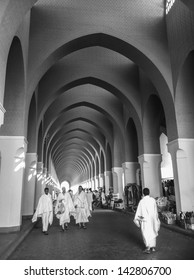 MEDINA, SAUDI ARABIA - JUN 1:Moslem pilgrims in 'ihram' cloth at a mosque on June 1, 2013 in Al Madinah. 'Ihram' clothes consist of two unhemmed white clothes intended to make everyone appear the same