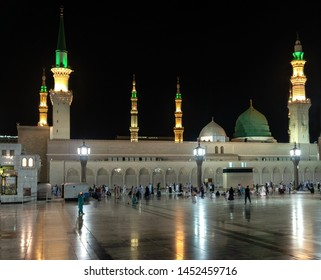 MEDINA, SAUDI ARABIA - JUNE 25: Muslims marching in front of the mosque of the Prophet Muhammad on June 25, 2019 in Medina, KSA. Prophet's tomb is under the green dome.