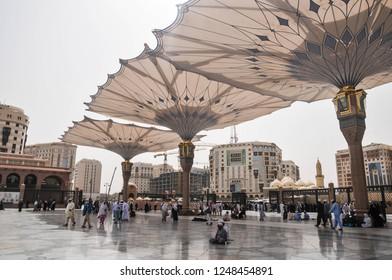 Medina, Saudi Arabia - June 7 2016:Pilgrims at the Nabawi Mosque at Medina, Saudi Arabia. Nabawi mosque originally built by the Islamic prophet Muhammad, situated in the city of Medina in Saudi Arabia