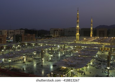 MEDINA, SAUDI ARABIA (KSA) - JAN 30: Muslims from different countries in the courtyard of the mosque of the Prophet on January 30, 2015 in Medina KSA. The mosque is the second holiest mosque in Islam.