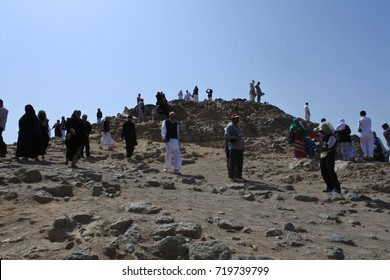 Medina, Saudi Arabia - March 01, 2017: Some people who are above the mountain Uhud, It is a mountain that has happened Uhud battle at the beginning of the deployment of the Islamic religion.