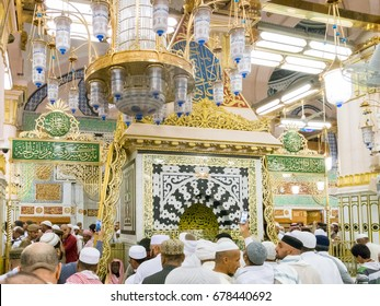 MEDINA, SAUDI ARABIA - MARCH 11, 2017 : Pilgrims pray, dua and reading koran inside Raudah in Nabawi Mosque infront of the  prophet muhammad s.a.w mihrab among the most blessed places of prayer
