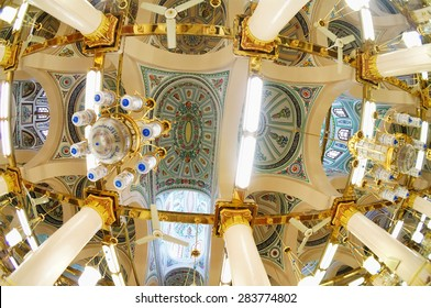 MEDINA, SAUDI ARABIA -MAY 2015 : Interior of Masjid Nabawi on May, 2015 in Medina, Saudi Arabia. Nabawi Mosque is the second holiest mosque in Islam and here is Prophet Muhammad is laid to rest