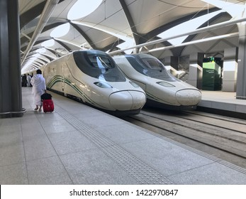 MEDINA, SAUDI ARABIA - MAY 27, 2019 :  an unidentified muslim pilgrim man in white ihram clothes ready to embark train coach at HSR Madinah station in Medina, Saudi Arabia.