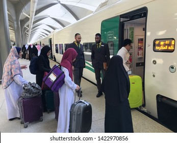 MEDINA, SAUDI ARABIA - MAY 27, 2019 :  a group of Muslim family ready to embark train coaches at HSR Madinah station in Medina, Saudi Arabia.