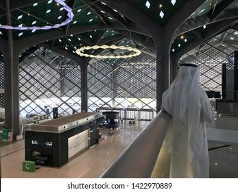 MEDINA, SAUDI ARABIA - MAY 27, 2019 :  Unidentified Arab men chat with each other inside HSR Madinah station in Medina, Saudi Arabia.