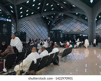 MEDINA, SAUDI ARABIA - MAY 27, 2019 : Unidentified Muslim pilgrims in white ihram clothes wait for a train at HSR Madinah station in Medina, Saudi Arabia.