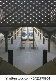 MEDINA, SAUDI ARABIA - MAY 27, 2019 :  Top view of Madinah Haramain station with bullet trains on tracks at HSR Madinah station in Medina, Saudi Arabia.