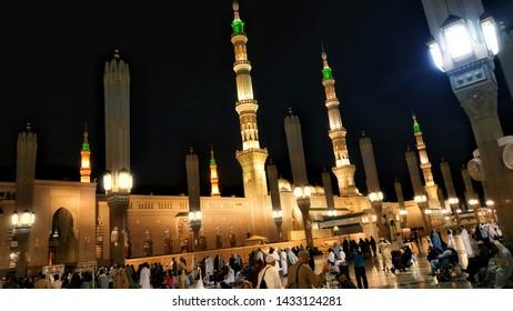 Medina, Saudi Arabia - May 6, 2019 : Exterior of Nabawi's Mosque building and electronic umbrella in Medina (Madinah) with selective focus and crop fragment.
