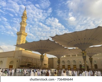 MEDINA, SAUDI ARABIA - SEPT 17, 2017: Minarets and The Giant Retractable Tent At Prophet Muhammad Mosque In Medina with clouds and blue sky