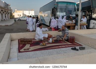 MEDINA, SAUDI ARABIA-CIRCA 2016: Two unidentified Arab men relax and drink tea at an eatery outlet in Al Madinah, Saudi Arabia.